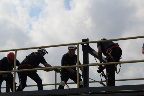 A technical rescue team working together on a mechanical advantage system