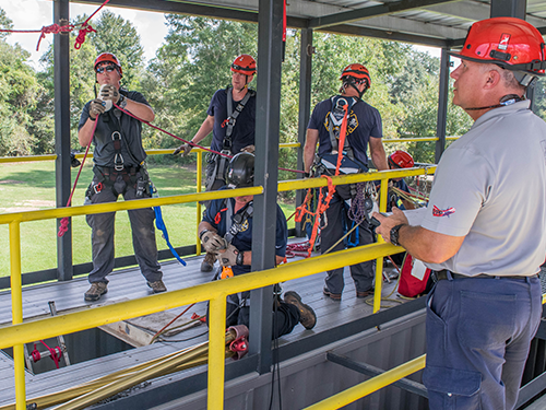 A technical rescue team preparing for training at the Roco Training Center